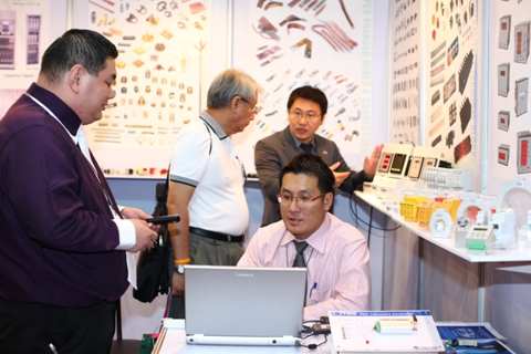 Thai business visitors in another exhibitors` booth