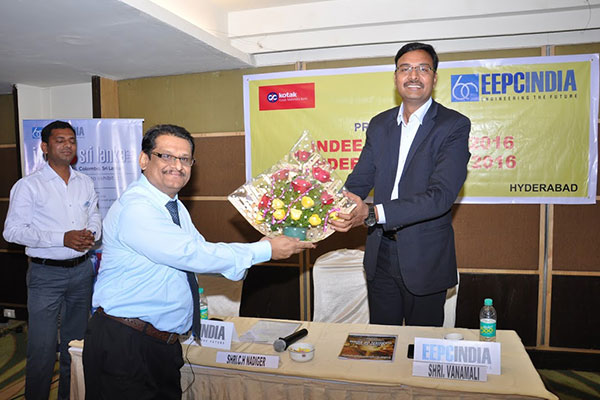 Welcoming with Floral bouquet to Mr. Vanamali, Area Manager, Kotak Mahindra Bank, Hyderabad, by Mr. C H Nadiger, Regional Director, EEPC INDIA, SR.