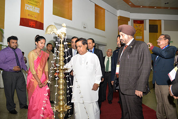 MR. NIMAL SIRIPALA DE SILVA, MINISTER OF TRANSPORT & CIVIL AVIATION, SRI LANKA LIGHTING THE SRI LANKAN TRADITIONAL OIL LAMP