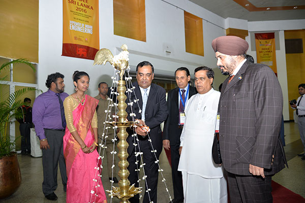 MR. Y. K SINHA, INDIAN HIGH COMMISSIONER TO SRI LANKA LIGHTING THE SRI LANKAN TRADITIONAL OIL LAMP