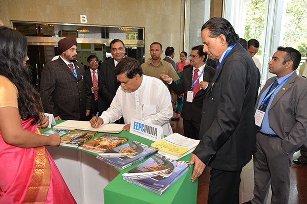 MR. NIMAL SIRIPALA DE SILVA, MINISTER OF TRANSPORT & CIVIL AVIATION, SRI LANKA EXPRESSING HIS COMMENTS ON OUR VISITOR BOOK AT EEPC INDIA`S THEME PAVILION