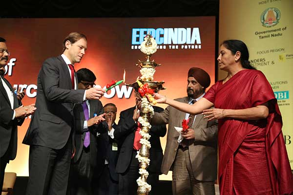 Lighting the lamp jointly by Ms. Nirmala Sitharaman, Minister of State (Independent Charge) for Commerce & Industry, Govt. of India and Mr. Denis Manturov, Minister of Industry and Trade of the Russian Federation. Mr. T. S. Bhasin, Chairman, EEPC India is also seen