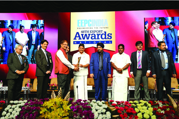 Trophy being presented by Mr. M. C. Sampath, Minister for Industries, Steel Control, Mines and Minerals and Special Initiatives, Govt. of Tamil Nadu to one of the Award Winners