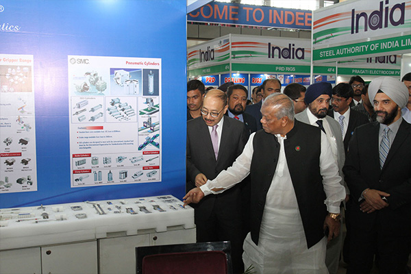 Mr Alhaz Amir Hossain Amu, Hon'ble Minister of Industries, Government of Bangladesh accompanied by ; Mr Harsh Vardhan Shringla, Indian High Commissioner to Bangladesh and Mr B S Bhalla, Joint Secretary, Department of Commerce , Ministry  of Commerce & Industry, Government of India taking a tour of the Stalls