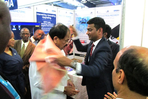 Hon`ble Vice President of India, Mr. Muppavarapu Venkaiah Naidu visiting the stalls in India Pavilion. Mr V C Ravish, Sr Executive Officer, EEPC India, Hyderabad is felicitating Hon'ble Vice President of India with Shawl