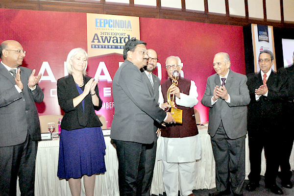 One of the proud award recipients gets the trophy from H.E. Mr Keshari Nath Tripathi, Honourable Governor of West Bengal