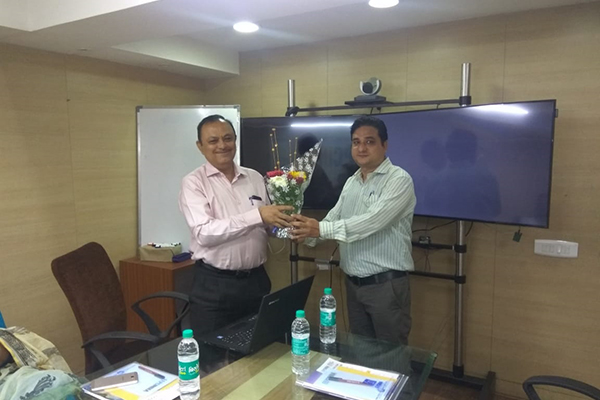 Mr Pratap Singh Bharda, Executive Officer, EEPC India, Regional Office, Mumbai presenting bouquet to the Speaker Mr Eknath Birari