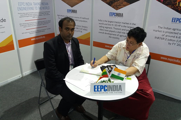 Mr Myo Thant, Joint Secretary General of UMFCCI signing Visitor's book in EEPC India booth