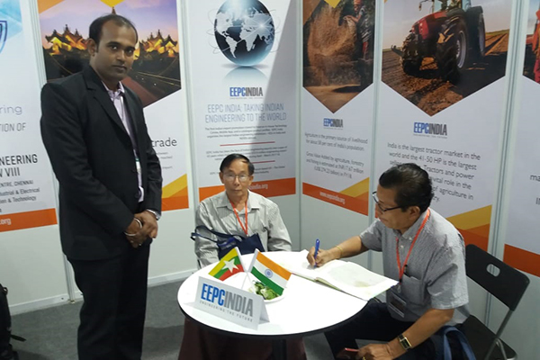 Mr Than Htay, Advisor, MAPCO ( Myanmar Agribusiness Public Corporation Ltd) signing Visitor's book in EEPC India booth