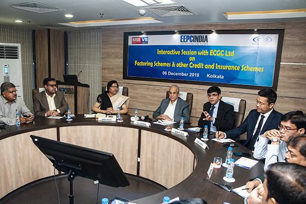 Mr. Subir Das, DGM & Regional Manager, ER, ECGC Ltd. briefing the house on their new products designed. On his left, Mr. C James Lalremruata, AGM & Branch Manager, Kolkata Exporter Branch & other ECGC officials. On his right, Mr. B  D Agarwal, Regional Chairman (E.R.), EEPC India; Mrs. Anima Pandey, Regional Director (ER) & Director (Membership), EEPC India and esteemed members of EEPC India