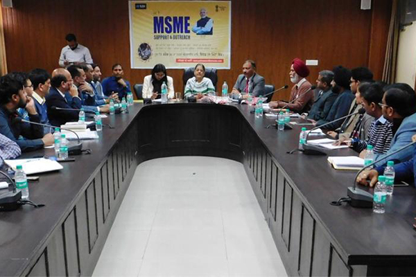 Prabhari Officer Ms Ravneet Kaur, IAS, CMD, ITDC, New Delhi (in the centre) addressing the gathering. In the headtable - on her left Mr Dharm Pal Gupta, IAS, Deputy Commissioner, Barnala and on her right Ms Ruhi Dugg, IAS, ADC (G); Mr Sandeep Kumar, IAS, SDM