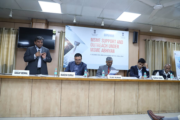 Mr. Sanjay Beswal, Director, Andees Consultant on Exim Solutions and FTP addressing the gathering. Sitting on the dais (from left to right) - Mr. Rakesh Suraj, Regional Director (N.R.), EEPC India; Mr Vijay Kumar, Director, MSME Development Institute, Govt. of India; Mr Ramesh Verma, Asst DGFT and Mr Mohan Lal Gupta, LDM, Okhla