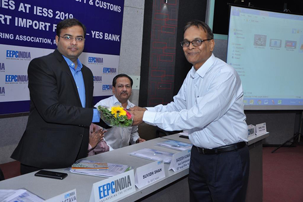 Mr A Jalavadia, Working Committee Member, EEPC India presenting a bouquet to Mr Suvidh Shah, DGFT, Rajkot
