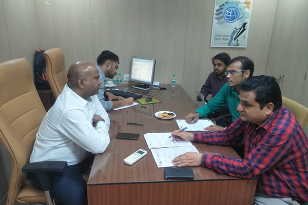 Mr. Rajesh Solanki, Superintendant, JNCH meeting queries about the shippng bill before the members present; on his left, Mr. Sumit Kumar, Preventive Officer, JNCH noting down the queries. Mr. Pratap Singh Bharda, Executive Officer, EEPC India, Mumbai is also seen along with the members.