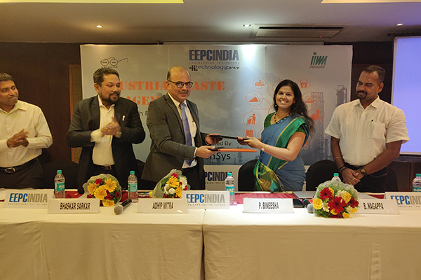 Exchange of Signed MoU between Mr. Adhip Mitra, Additional Executive Director & Secretary, EEPC India and Ms. P. Bineesha, Executive Director, IIWM ( International Institute of Waste Management).