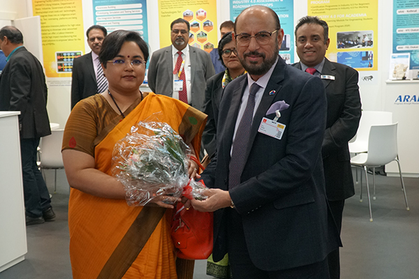Mr Ravi Sehgal, Chairman, EEPC India presenting bouquet  Ms  Paramita Tripathi, Dy Chief of Mission, Embassy of India, Berlin