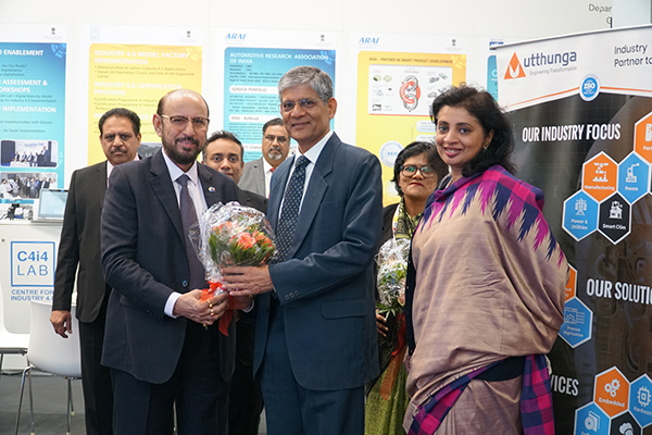 Mr Ravi Sehgal, Chairman, EEPC India presenting bouquet to Dr A R Sihag, Secretary, DHI (Department of Heavy Industry), Government of India. Mr Mukesh Samtani, Assistant Director, EEPC India