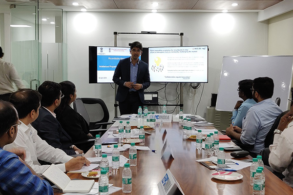 Mr. Nitin Chakki, Manager - Invest India is giving presentation on Invest India.