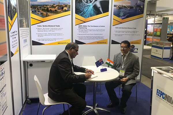 Mr. Rakesh Malhotra, Consul General of India, Melbourne, is signing on the Visitors Book after his visit in EEPC India Pavilion at National Manufacturing Week was held during 14 to 17 May, 2019 in Melbourne, Australia. Mr. C. H. Nadiger, Regional Director (SR), EEPC India is also present.