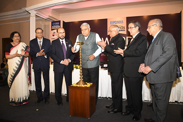 Lamplighting by H.E Mr Jagdeep Dhankhar, Hon`ble Governor of West Bengal (4th from left) ,Mr Ravi Sehgal,Chairman,EEPC India (3rd from left), Mr G.D.Shah,Past Chairman, EEPC India (third from right),Mr Arun Kumar Garodia, Vice Chairman,EEPC India (2nd from right), Mr B D Agarwal,Regional Chairman(ER),EEPC India (far right),Mr L. P.Gupta,Dy Regional Chairman(ER),EEPC India and Ms Anima Pandey,Regional Director(ER) and Director(Membership),EEPC India