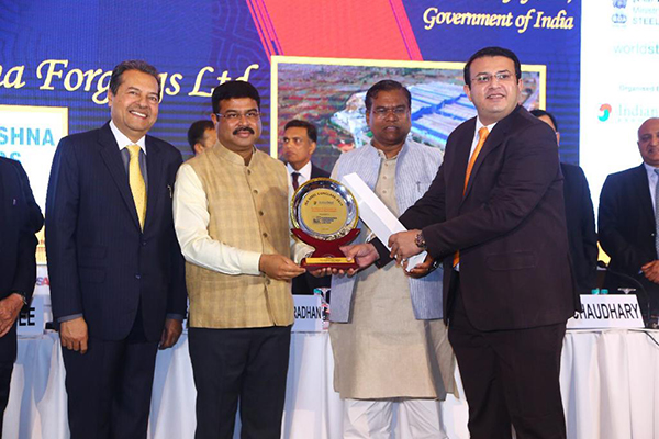 Excellence in Innovation by Downstream Steel Industry- M/s Ramkrishna Forgings Ltd.   Mr. Milesh Gandhi, Vice President (Marketing & Sales), Ramkrishna Forgings Ltd is receiving the award from Shri Dharmendra Pradhan, Hon'ble Union Minister, Petroleum & Natural Gas and Steel, GoI and Shri Faggan Singh Kulaste, Hon'ble Union Minister of State, Ministry of Steel, GoI. Dr. Bhaskar Chatterjee, Secretary General And Executive Head, Indian Steel Association is also present.