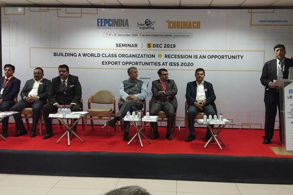 Mr K L Dhingra, Regional Chairman (WR), EEPC India is addressing the audience. Dr Rajat Srivastava, Regional Director (WR) & Director (Marketing & Sales) (3rd from left); Mr Shafee Maniar, Working Committee Member, EEPC India (WR) (3rd from right) and Mr Sudhakaran Nair, Dy Director, EEPC India, SRO Ahmedabad (1st from right) are seen on the dais along with other dignitaries.